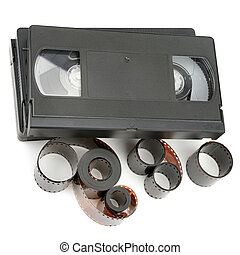 A set of video tapes and photographic film isolated on white background.