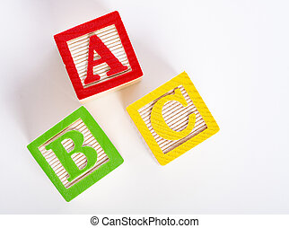 Wooden ABC blocks on white background