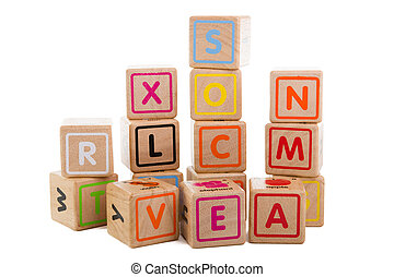 A set of wooden blocks with letters on white background