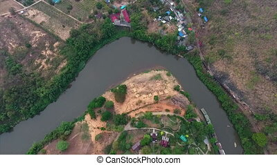 A settlement close to a river - An aerial view of a river...