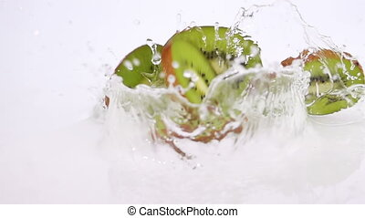 A Several Slices of Kiwi are Falling on the Table.