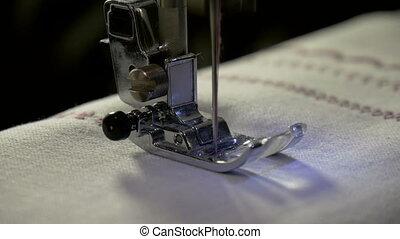 A sewing machine, sew the fabric