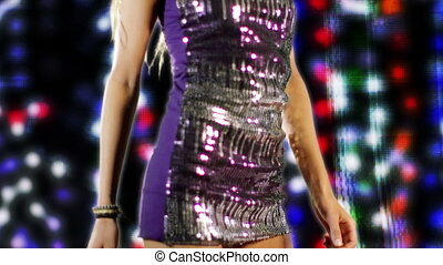 a sexy woman dances in a sparkly disco dress, shot in high quality with the sony NEX-FS100