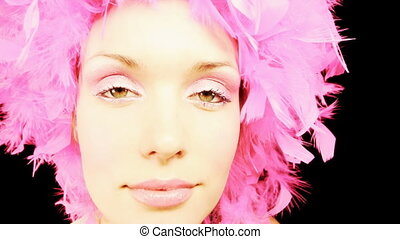 a sexy woman dances with pink crazy hairstyle