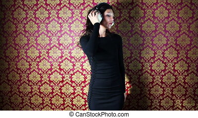 a sexy woman dances with retro white headphones against a ...
