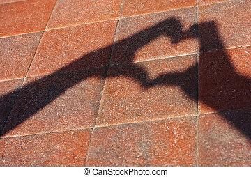 heart shape - a shadow heart shape on the floor.