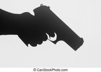A shadow of a pistol being held