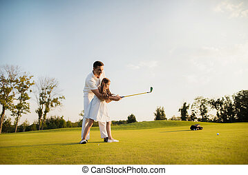 A sharp blow to the ball with a golf club. the girl made her first hit in golf