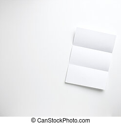 a sheet of blank folded letter paper copyspace on a white...