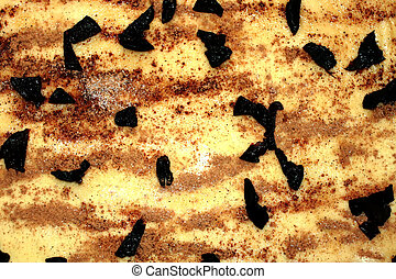 A sheet of dough sprinkled with cinnamon, sugar and prune pieces. texture.