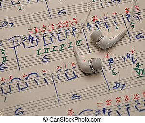 A sheet of music with earphones