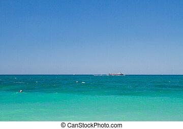 A ship on the horizon of the black sea