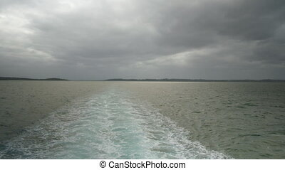 A ship's beautiful water trail - A wide shot of the sea. A...