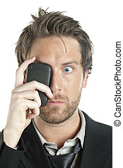a shocked man with cellphone covering her eye