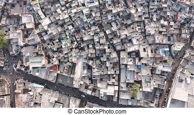 A Shocking Aerial Footage of Clustered housing in Agra , Uttar Pradesh, India depicting Overpopulation , Global Warming and Human Carbon Footprints, Looking Down Shot . High quality 4k footage