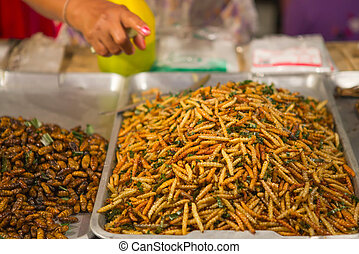 A shop sell silkworm pupa fried, delicious food in Thailand