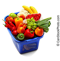 A shopping basket full of fresh produce on white.