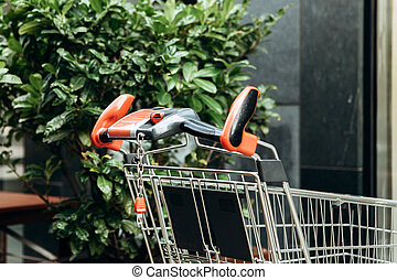 A shopping trolley at the entrance to the store.