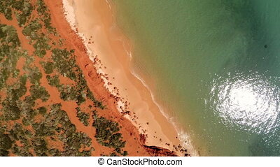 A shoreline and the sea with cliff - A bird's eye view shot...