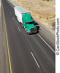 A shot from above a California freeway and local transporting activities