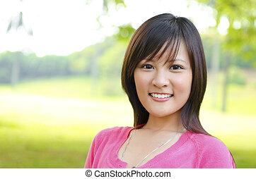Asian woman outdoor - A shot of a beautiful Asian woman...