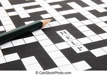 a shot of a crossword puzzle and pen