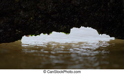 A shot of a rusted hole filling with water - A close-up shot...