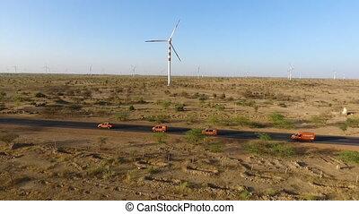 A shot of a wind turbine field in India