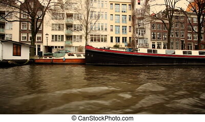 a shot of canal and street scene in amsterdam