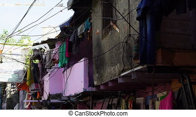 A shot of clothes draped around a home in India - A high...