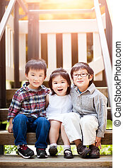Asian kids - A shot of three cute little Asian kids smiling