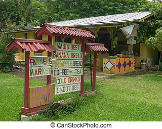 a sign advertises fresh fruit for sale at a roadside stand ...