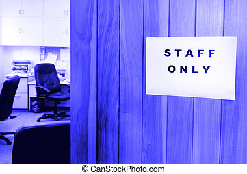 A sign reads Staff only in a office door.