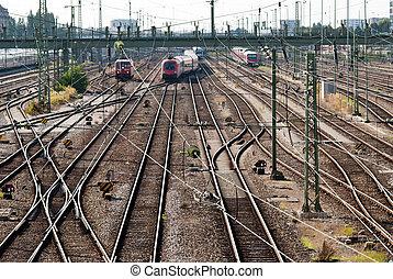 many rails - a signal box with many rails and trains