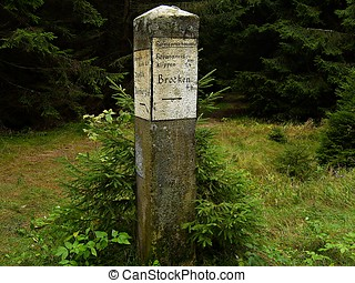 a signpost on a hiking trail
