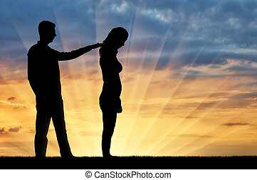 A silhouette of a man morally supports a sad woman