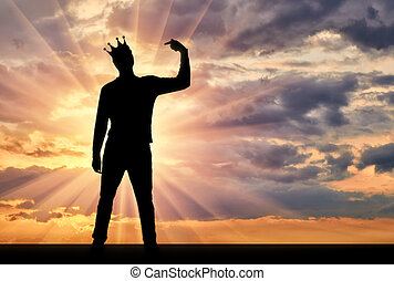 A silhouette of a narcissistic man with a crown on his head...