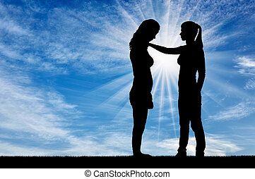 A silhouette of a woman morally supports another woman