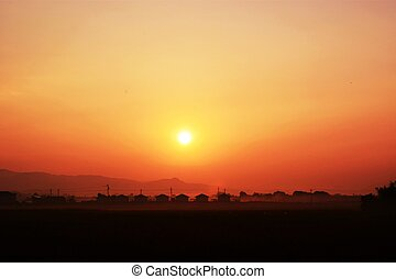 A silhouette of houses of sunrise