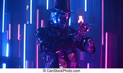 A silver dancing man in a glittering metal suit dances.