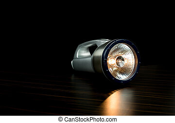 A Silver Flashlight isolated on black background