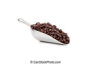 A silver scoop with whole coffee beans on a white background with copy space