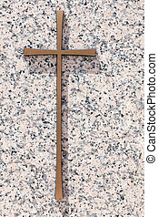 A simple gold memorial cross on a polished light pink granite slab, copy space