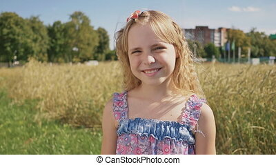 A simple shooting of a young blonde girl on a sunny summer day.