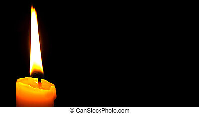 A single candle shining in the dark