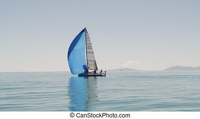A single sailboat in the middle of the ocean - A long wide...