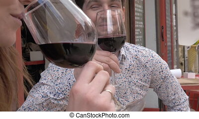 A sip of wine with a fiance - A young man drinking red wine ...
