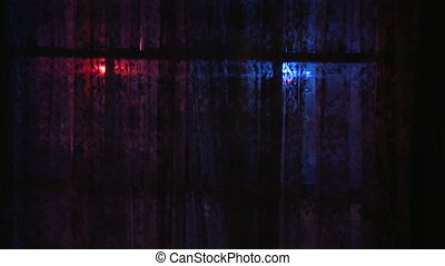 A siren in front of a window - A shot from inside a house. A...