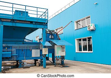 A site for loading waste into containers. The control panel for the process of loading.