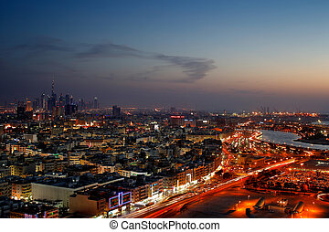 A skyline panorama of Dubai at dusk